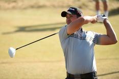 Jun 20, 2015; University Place, WA, USA; Jason Day hits his tee shot on the 18th hole in the third round of the 2015 U.S. Open golf tournament at Chambers Bay. Mandatory Credit: John David Mercer-USA TODAY Sports