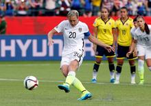 Jun 22, 2015; Edmonton, Alberta, CAN; United States forward Abby Wambach (20) kicks a penalty kick during the second half against the Colombia in the round of sixteen in the FIFA 2015 women's World Cup soccer tournament at Commonwealth Stadium. Mandatory Credit: Erich Schlegel-USA TODAY Sports -
