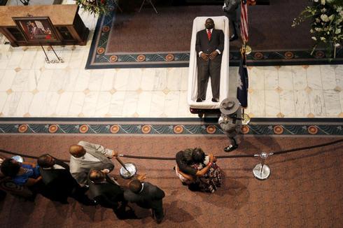 Charleston pastor lies in state