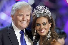 Donald Trump, co-owner of the Miss Universe Organization, poses with Miss Connecticut Erin Brady at a news conference after she was crowned Miss USA 2013 at the Planet Hollywood Resort and Casino in Las Vegas, Nevada in a June 16, 2013 file photo.  REUTERS/Steve Marcus/files
