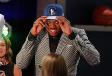 Jun 25, 2015; Brooklyn, NY, USA; NBA draft pick  Karl-Anthony Towns walks off stage after being picked first in the 2015 NBA draft at Barclays Center.  Brad Penner-USA TODAY Sports
