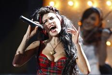 British singer Amy Winehouse performs at the Brit Awards at Earls Court in London in this February 20, 2008 file photo. REUTERS/Alessia Pierdomenico/Files