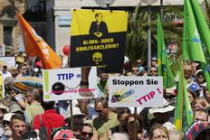 People demonstrate against the Transatlantic Trade and Investment Partnership (TTIP) a proposed free trade agreement between the European Union and the United States, during a protest rally prior to the G7 summit, in Munich, Germany in this June 3, 2015 file picture. REUTERS/Wolfgang Rattay/Files