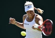 Angelique Kerber of Germany plays a shot during her match against Carina Witthoeft of Germany at the Wimbledon Tennis Championships in London, June 30, 2015.  REUTERS/Toby Melville
