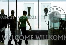 Staff are pictured in the entrance of UEFA in Nyon May 27, 2010. REUTERS/Denis Balibouse