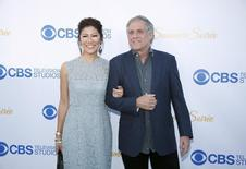 President and CEO of CBS Corp. Leslie Moonves (R) and TV personality Julie Chen (L) pose at the CBS Studios rooftop summer soiree in West Hollywood, California May 18, 2015. REUTERS/Danny Moloshok