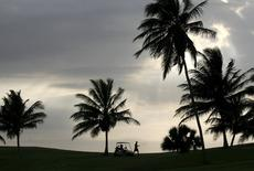 A man walks in a golf course in Varadero, Cuba, in this May 4, 2008 file photograph. REUTERS/Claudia Daut/Files
