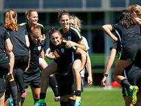 Jul 3, 2015; Vancouver, BC, CAN; United States defender Ali Krieger (center) carries midfielder Carli Lloyd while playing a game during a training session for the 2015 Women's World Cup at Empire Field South. Mandatory Credit: Michael Chow-USA TODAY Sports