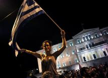 """""""No"""" supporters celebrate their victory in the referendum by the parliament in Athens, Greece July 5, 2015. REUTERS/Dimitris Michalakis"""