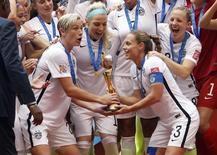 Jul 5, 2015; Vancouver, British Columbia, CAN; United States forward Abby Wambach (20) and United States defender Christie Rampone (3) hoist the trophy after defeating Japan in the final of the FIFA 2015 Women's World Cup at BC Place Stadium. Michael Chow-USA TODAY Sports