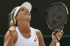 Coco Vandeweghe of the U.S.A. celebrates after winning her match against Lucie Safarova of the Czech Republic at the Wimbledon Tennis Championships in London, July 6, 2015. REUTERS/Stefan Wermuth