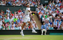 Tennis - Wimbledon - All England Lawn Tennis & Croquet Club, Wimbledon, England - 6/7/15 Men's Singles - Switzerland's Roger Federer in action during his fourth round match  Mandatory Credit: Action Images / Andrew Couldridge Livepic EDITORIAL USE ONLY.