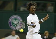 Gael Monfils of France plays a shot during his match against Gilles Simon of France at the Wimbledon Tennis Championships in London, July 4, 2015. REUTERS/Stefan Wermuth