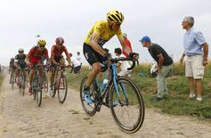 Team Sky rider Chris Froome of Britain (R) cycles on a cobble-stoned section during the 223.5-km (138.9 miles) 4th stage of the 102nd Tour de France cycling race from Seraing in Belgium to Cambrai, France, July 7, 2015.   REUTERS/Stefano Rellandini