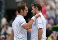 France's Richard Gasquet embraces Switzerland's Stanislas Wawrinka after winning his quarter final match Mandatory Credit: Action Images / Tony O'Brien Livepic