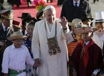 Pope Francis waves after his arrival in El Alto, Bolivia, July 8, 2015. REUTERS/David Mercado