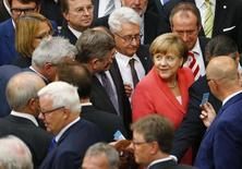 German Chancellor Angela Merkel prepares to vote during the session of Germany's parliament, the Bundestag, in Berlin, Germany, July 17, 2015. REUTERS/Axel Schmidt