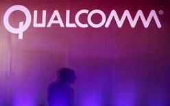 A shadow is cast near a Qualcomm logo at the 2015 Computex exhibition in Taipei, Taiwan, June 2, 2015. REUTERS/Pichi Chuang