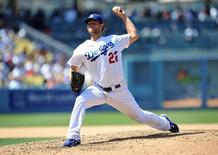 Los Angeles Dodgers starting pitcher Clayton Kershaw (22) pitches the seventh inning against Los Angeles Angels at Dodger Stadium. Mandatory Credit: Gary A. Vasquez-USA TODAY Sports