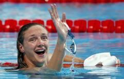 Katinka Hosszu of Hungary celebrates after setting new world record and winning the women's 200m individual medley final during the Aquatics World Championships in Kazan, Russia  August 3, 2015.   REUTERS/Hannibal Hanschke