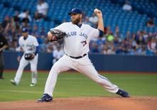 Aug 6, 2015; Toronto, Ontario, CAN; Toronto Blue Jays starting pitcher Mark Buehrle (56) throws a pitch during the first inning in a game against the Minnesota Twins at Rogers Centre. Nick Turchiaro-USA TODAY Sports