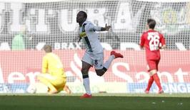 Borussia Moenchengladbach's Ibrahima Traore celebrates after scoring a goal during their Bundesliga first division soccer match against Bayer Leverkusen in Moenchengladbach, Germany May 9, 2015.   REUTERS/Ina Fassbender