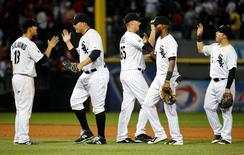 Aug 10, 2015; Chicago, IL, USA; Chicago White Sox third baseman Tyler Saladino (18), fielder Avisail Garcia (26) relief pitcher Nate Jones (65), shortstop Alexei Ramirez (10) and second baseman Carlos Sanchez (5) celebrate a win against the Los Angeles Angels at the end of their baseball game at U.S Cellular Field. Mandatory Credit: Kamil Krzaczynski-USA TODAY Sports