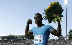 Justin Gatlin of the U.S. celebrates after winning the 100 meters men event at the IAAF Diamond League Athletissima athletics meeting at the Pontaise Stadium in Lausanne, Switzerland, July 9, 2015. REUTERS/Pierre Albouy