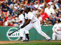 Aug 15, 2015; Boston, MA, USA; Boston Red Sox right fielder Jackie Bradley Jr. (25) hits a home run against the Seattle Mariners during the eighth inning at Fenway Park.  Mark L. Baer-USA TODAY Sports