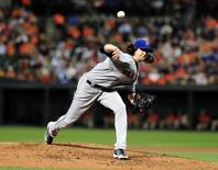 Aug 18, 2015; Baltimore, MD, USA; New York Mets pitcher Jacob deGrom (48) throws a pitch in the second inning against the Baltimore Orioles at Oriole Park at Camden Yards. Evan Habeeb-USA TODAY Sports