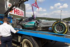 The car of Mercedes Formula One driver Nico Rosberg of Germany is brought back to the garage after suffering a tyre failure during a free practice session ahead of the weekend's Belgian F1 Grand Prix in Spa-Francorchamps, Belgium, August 21, 2015. REUTERS/Michael Kooren