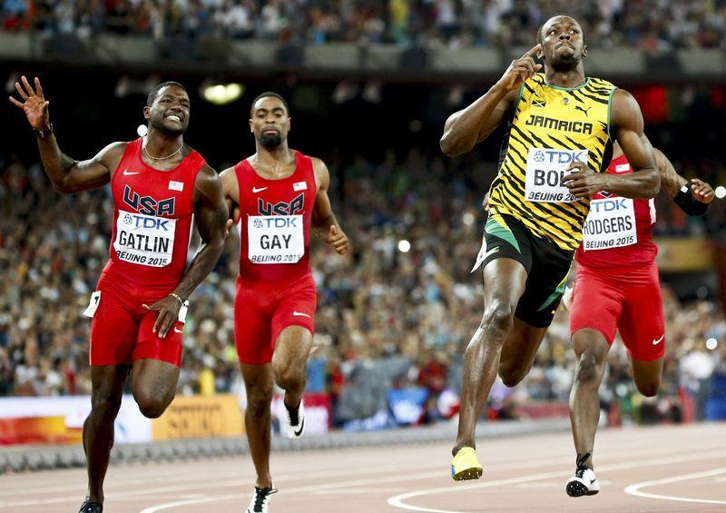 Justin Gatlin and Tyson Gay from the U.S. and Usain Bolt (L-R) of Jamaica  compete in the men s 100m final during the 15th IAAF World Championships at  the ... b675ac5bc