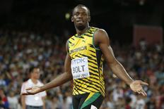 Usain Bolt of Jamaica gestures before his men's 200 metres heat at the 15th IAAF World Championships at the National Stadium in Beijing, China August 25, 2015.  REUTERS/Phil Noble
