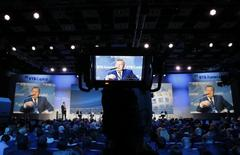 """Oleg Budargin, director-general of JSC """"Russian Grids"""", is seen on screens as he speaks during the VTB Capital """"Russia Calling!"""" Investment Forum in Moscow, October 1, 2014. REUTERS/Maxim Shemetov (RUSSIA - Tags: BUSINESS ENERGY)"""