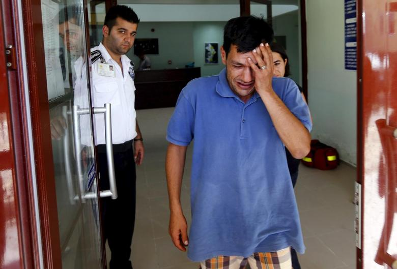 Abdullah Kurdi, father of three-year old Aylan Kurdi, cries as he leaves a morgue in Mugla, Turkey, September 3, 2015. REUTERS/Murad Sezer