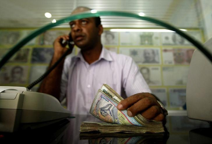 A Man Counts Sri Lankan Rus At Money Exchange Counter In Colombo June 11 2017 Reuters Dinuka Liyanawatte Files