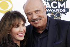 Author Robin McGraw and TV personality Phil McGraw arrive at the 50th Annual Academy of Country Music Awards in Arlington, Texas April 19, 2015.    REUTERS/Mike Stone