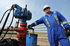 Sr. foreman Dwayne Roy checking tap for production at an active well site about 60 kilometres east of field office during a tour of Gear Energy's well sites near Lloydminster, Saskatchewan August 27, 2015. REUTERS/Dan Riedlhuber