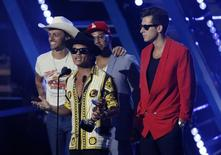 "Mark Ronson (R) and Bruno Mars (holding trophy) accept the award for best male video for ""Uptown Funk"" at the 2015 MTV Video Music Awards in Los Angeles, California August 30, 2015.  REUTERS/Mario Anzuoni"