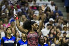 Serena Williams of the U.S. exercises between sets to stay warm during her match against Vitalia Diatchenko of Russia at the U.S. Open Championships tennis tournament in New York, August 31, 2015. REUTERS/Lucas Jackson