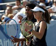 Martina Hingis of Switzerland plays with mixed doubles partner Leander Paes of India during their finals match against Bethanie Mattek-Sands and Sam Querrey of the U.S. at the U.S. Open Championships tennis tournament in New York, September 11, 2015.  REUTERS/Shannon Stapleton  Picture Supplied by Action Images