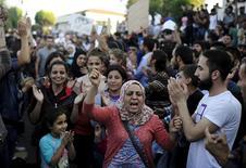 Imigrantes protestam em estação de ônibus em Istambul.  15/9/2015.  REUTERS/Yagiz Karahan