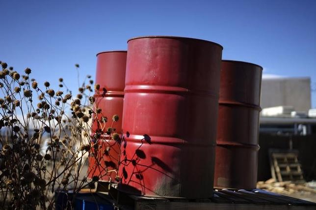 Oil barrels sit empty at a recycling yard in Longmont, Colorado February 2, 2015. REUTERS/Rick Wilking