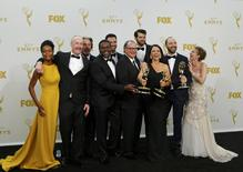 "Cast members of HBO's ""Veep,"" from left, Sufe Bradshaw, Matt Walsh, Sam Richardson, Reid Scott, Kevin Dunn, Timothy Simons, Julia Louis-Dreyfus, Tony Hale and Anna Chlumsky, pose backstage after the show won the award for Outstanding Comedy Series during the 67th Primetime Emmy Awards in Los Angeles, California September 20, 2015.  REUTERS/Mike Blake"