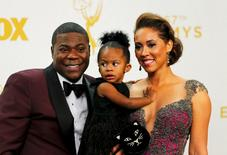 Actor Tracy Morgan and his wife, Megan Wollover, pose backstage with their child during the 67th Primetime Emmy Awards in Los Angeles, California September 20, 2015.  REUTERS/Mike Blake