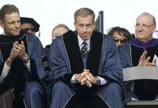 NBC News anchor Brian Williams is applauded as he receives an honorary doctorate in humane letters during commencement ceremonies from George Washington University on the National Mall in Washington, May 20, 2012.   REUTERS/Jonathan Ernst