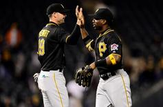 Sep 22, 2015; Denver, CO, USA; Pittsburgh Pirates catcher Chris Stewart (19) and center fielder Andrew McCutchen (22) celebrate the win over the Colorado Rockies at Coors Field. The Pirates defeated the Rockies 6-3. Mandatory Credit: Ron Chenoy-USA TODAY Sports