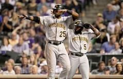 Pittsburgh Pirates right fielder Gregory Polanco (25) and third baseman Josh Harrison (5) react back to left fielder Starling Marte (not pictured) after both scoring on his double in the fourth inning against the Colorado Rockies at Coors Field. Sep 23, 2015; Denver, CO, USA. Ron Chenoy-USA TODAY Sports