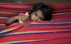 A Colombian Nukak Maku Indian child rests in a refugee camp at Agua Bonita near San Jose del Guaviare of Guaviare province September 3, 2015. REUTERS/John Vizcaino