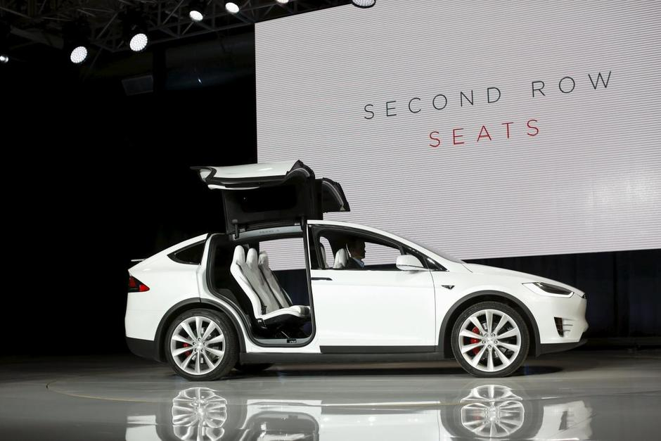 A Tesla Motors Model X Electric Sports Utility Vehicle Opens Its Falcon Wing Doors On Stage During Presentation In Fremont California September 29 2017
